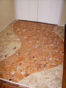 mosaic stone entryway, mosaic in foyer, stone, pebbles rock mosaic floor